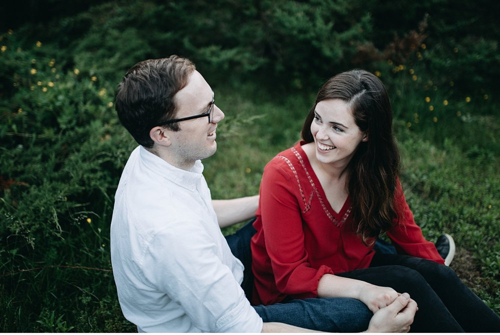 Couple laughing at Arnold Arboretum during casual engagement session
