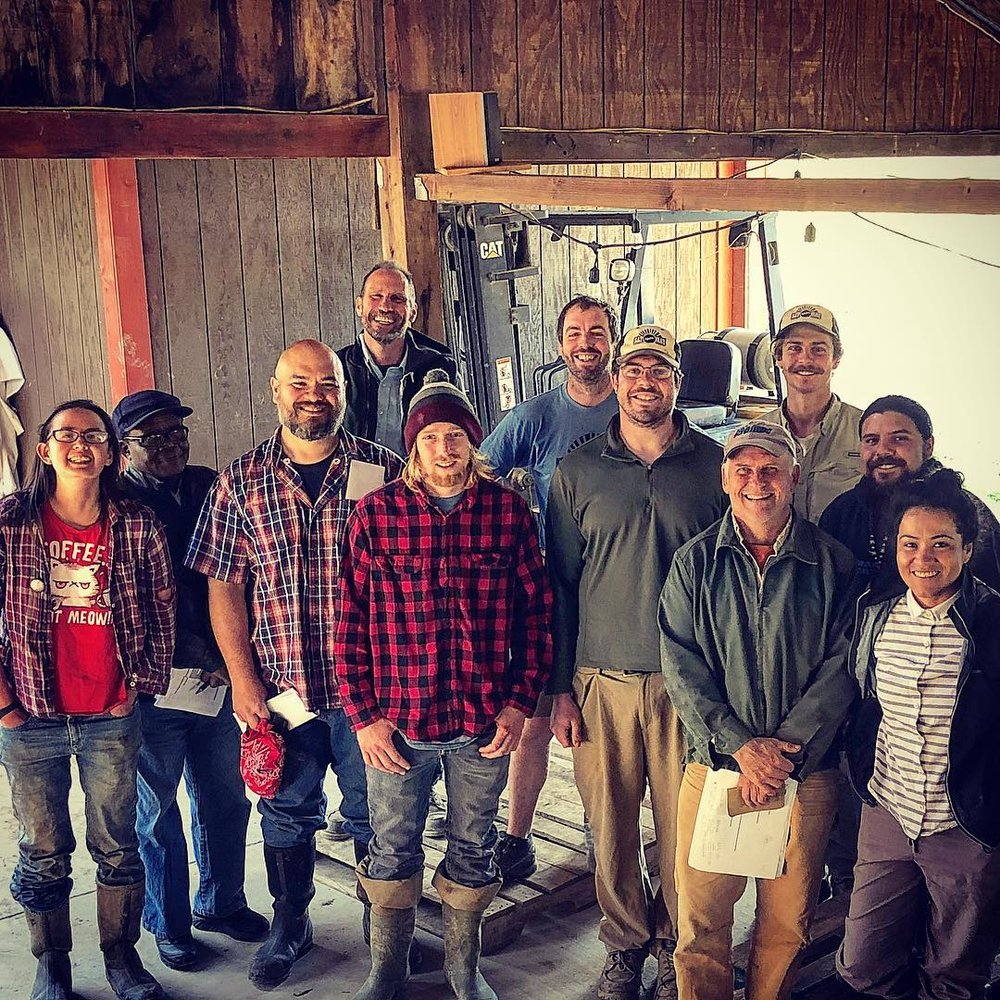 After our weekly Tuesday meeting: Quick group shot of just some of the smiling, smart people that grow your food here at Say Hay. We're spending some valuable spring time to double down on organization and communication as we continue to evolve better systems.