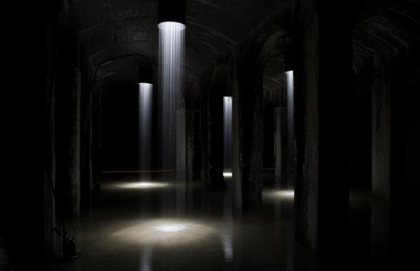 """33 years since the cisterns were drained, the water is returned to the 4,320-square-foot water reservoir deep below Søndermarken. As visitors will be surrounded by water, both in the form of a large water surface covering the floor and 28 columns of shining falling water. Via walkways you move into an unknown darkness. The water mirror, reflects and is co-creator of both the visual and the musical part of the project, created by composer Martin Hall.""  From the installation website."