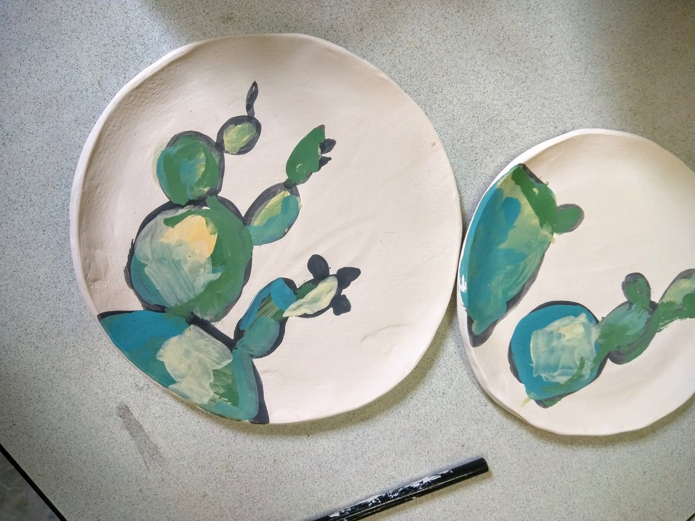 Possibly, for the first time ever, a glazing experiment went entirely as planned! Above are images of the underglaze being painted on... and below are the finished pieces. Drooling over these little ones.