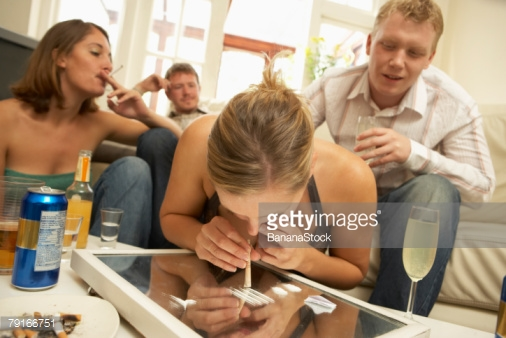 "Photo by BananaStock/BananaStock / Getty Images - Yes, this is a stock photo you can license for ten bucks. It's called ""Woman snorting cocaine at party"". We're almost as excited as she's about to become."