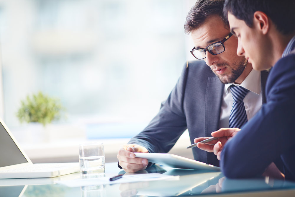 stock-photo-young-manager-listening-to-his-colleague-explanations-263495984.jpg