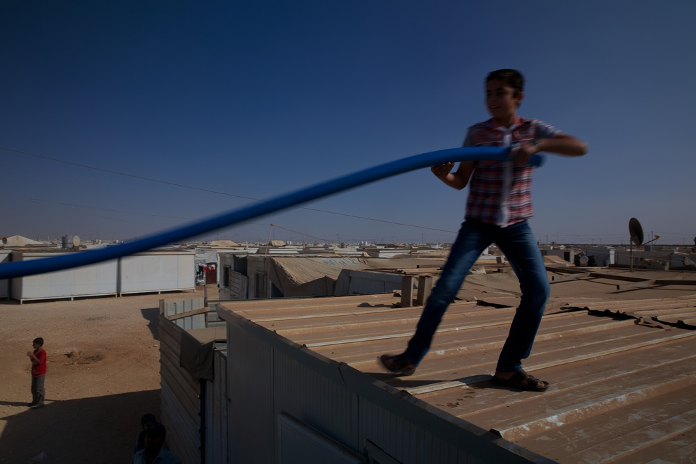 Water is delivered to Syrian refugees inside the Zaatari camp in Jordan.