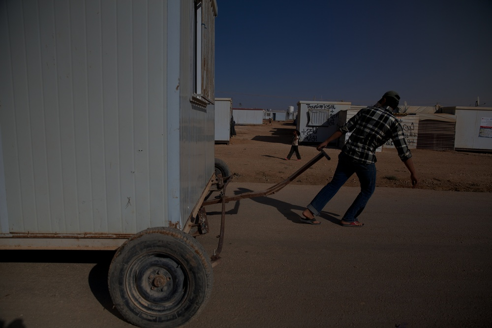 Syrian refugees move a house through the Zaatari refugee camp in Jordan.