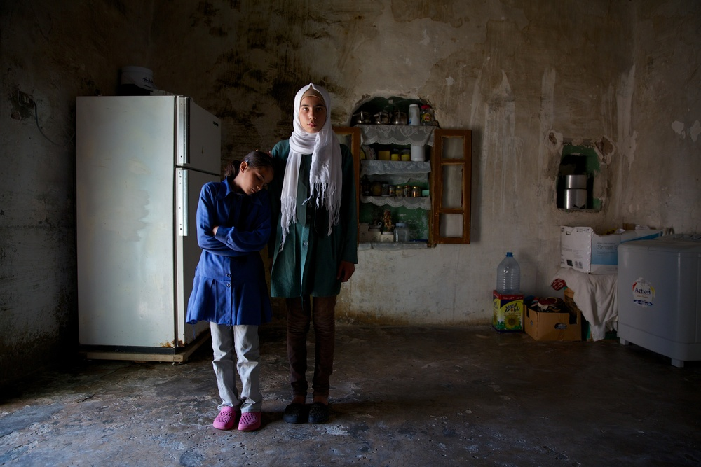 Sisters, now refugees from Syria, at their home in Jordan.