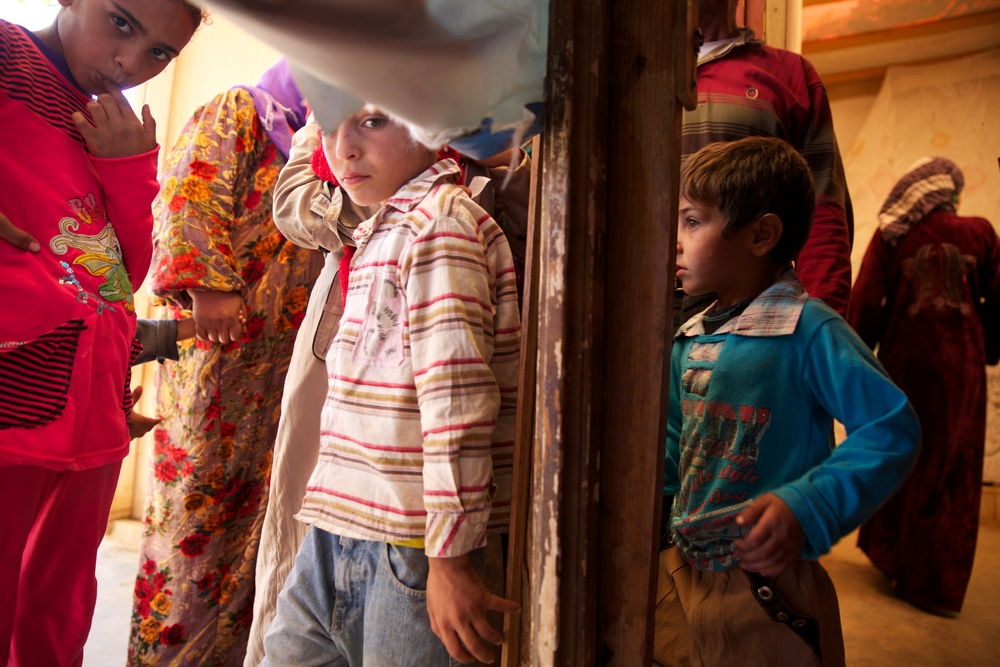 Syrian children wait to see a doctors from the US and Europe at a refugee camp in Lebanon.