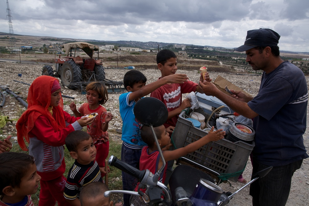 Ice cream delivery at a refugee camp in Lebanon.