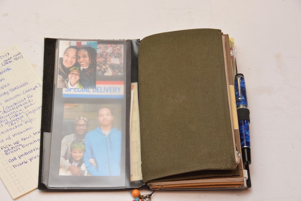 I intermingle useful things with memories. The olive green canvas insert was purchased at a Traveler's Company Caravan (pop-up event) and it holds my money, coupons, and necessary cards.