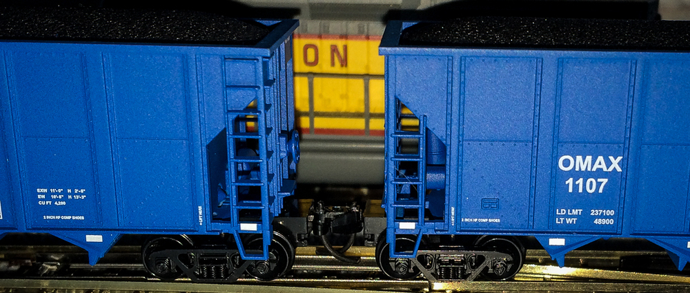 These N-scale hoppers cars are only about an inch high.