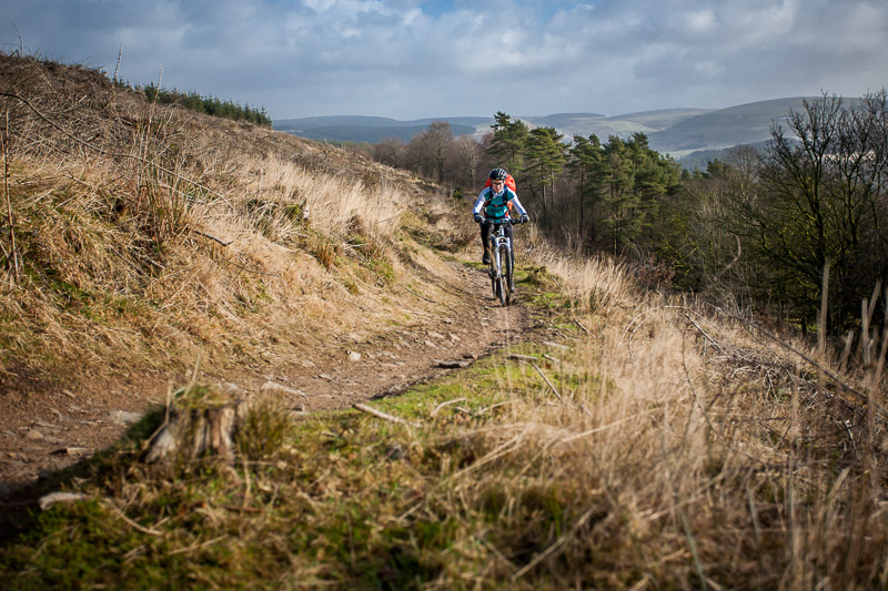 Bex rides along a trail in Afan Forest Park