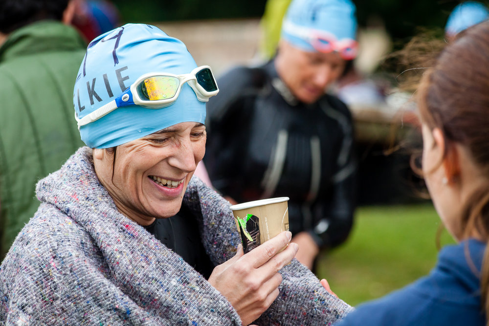 The Thames Marathon is a bit different to the other Henley Swim events - at 14km in length it takes some real commitment to enter it, let alone finish it! 2016 was the first year I shot it, and the 5 hours spent walking and cycling alongside the swimmers felt like an adventure on it's own. This lady is having a well deserved hot drink and an energy gel at a mid-course feed station. Anyone who finishes this event definitely has my respect.