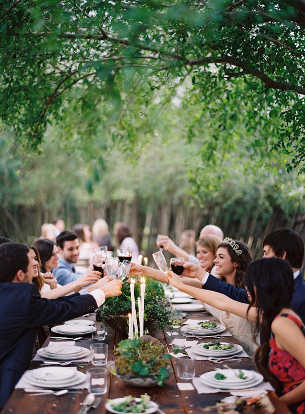 cheers-toast-wedding-reception-wine-under-trees-backyard-outdoor-dinner-friends-alfresco.jpg
