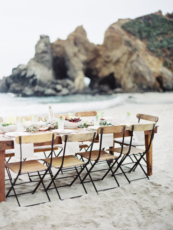 pfeiffer-beach-wedding-reception-lunch-long-wooden-table-chairs.jpg