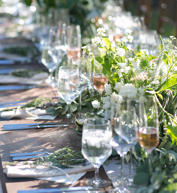 blush-wedding-reception-dinner-farm-tables-garland-outdoors-destination-wedding-studio-choo-joy-thigpen-big-sur.jpg