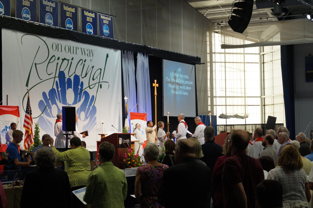 "The processional hymn for opening worship was ""Lift High the Cross."""