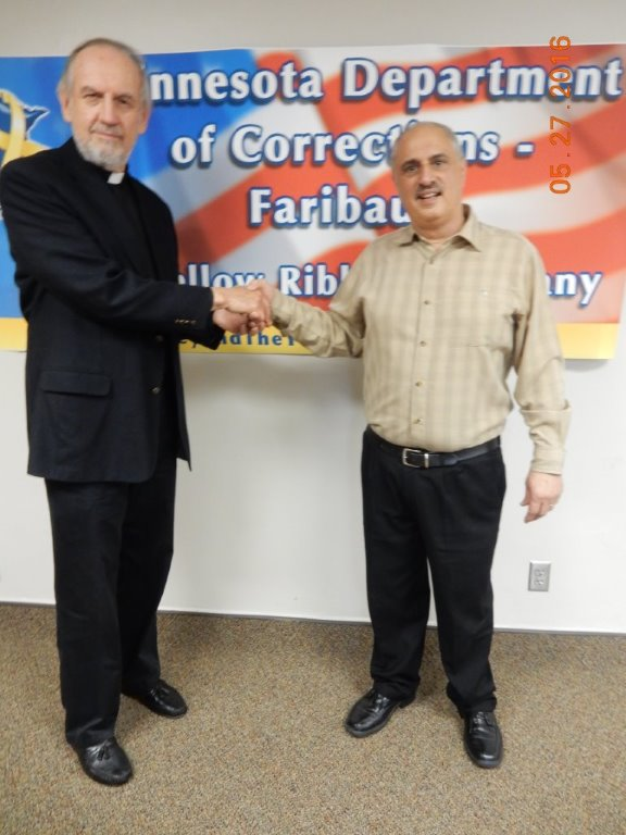 Rev. Paul Emmel (left) is pictured with Faribault prison chaplain Tony Mustazza.