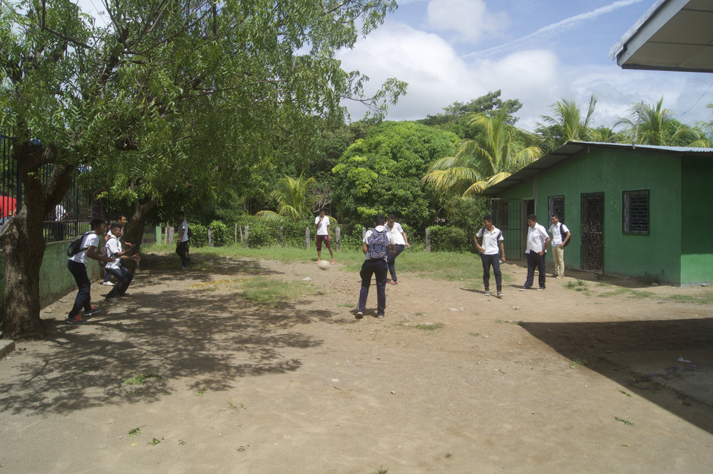 Students at the Christian school play soccer during a break.