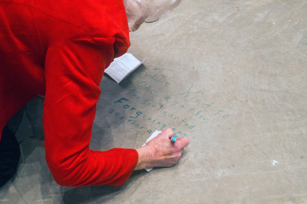 Members of River of life wrote bible verses on the concrete floor of the new sanctuary before carpet was installed.