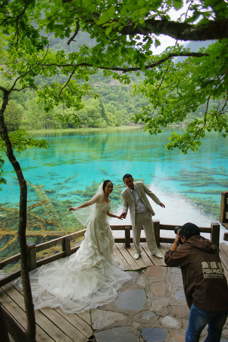 A couple have their wedding photos taken (Jiuzhaigou National Park, China)