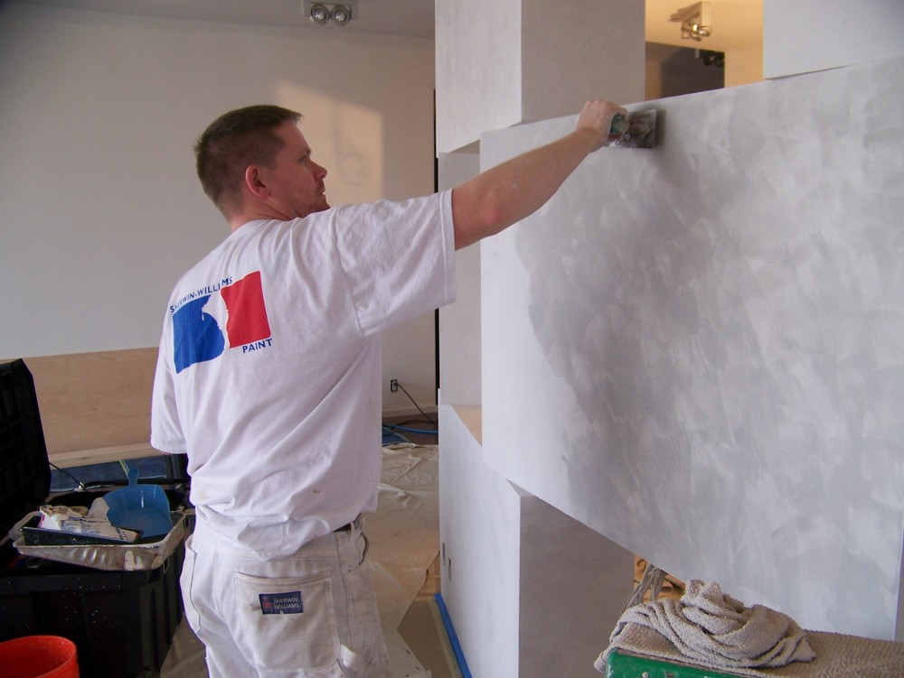 Carl Pledger applying Italian Plaster