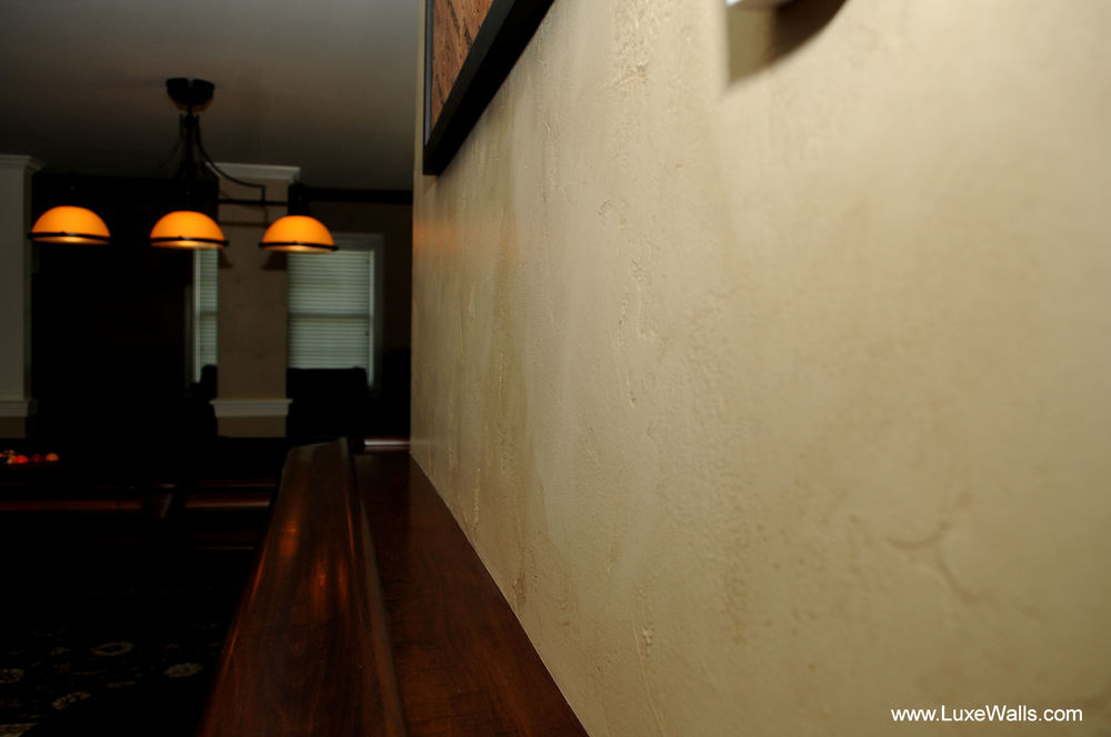 The main wall finish is this textured and glazed technique which serves to add warm and ambiance to the basement.