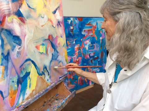 Lynn LeTourneau painting at her studio
