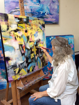 Lynn LeTourneau painting in studio