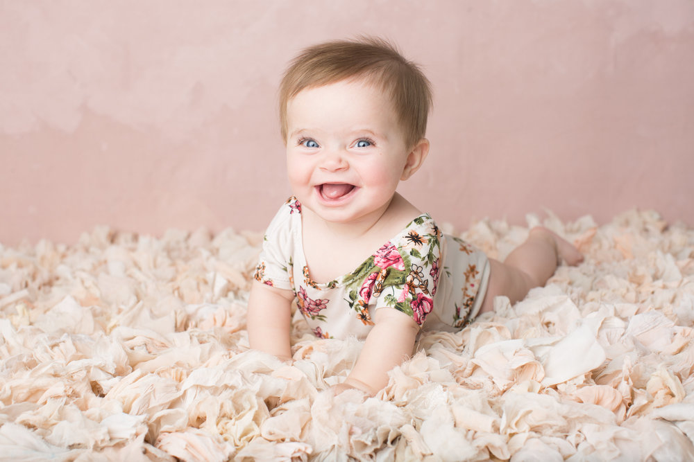 Milestone Studio Session $375  It's a proud moment when a baby lift their head up, sits upright unassisted, and stands tall. These sessions document those sweet milestones. It also documents the change from infant to toddler. Galleries typically have 30-40 images.