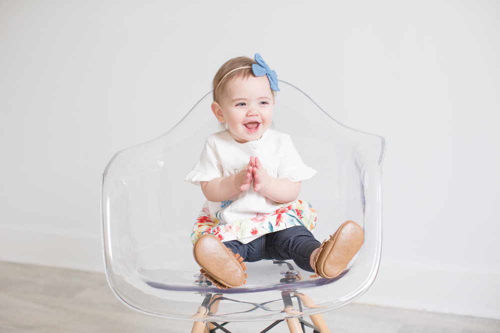 First - we'll start with a quick one pose session of your baby in a neutral scene wearing an outfit of your choice. While we take these photos we'll get the nursery styled for your session.