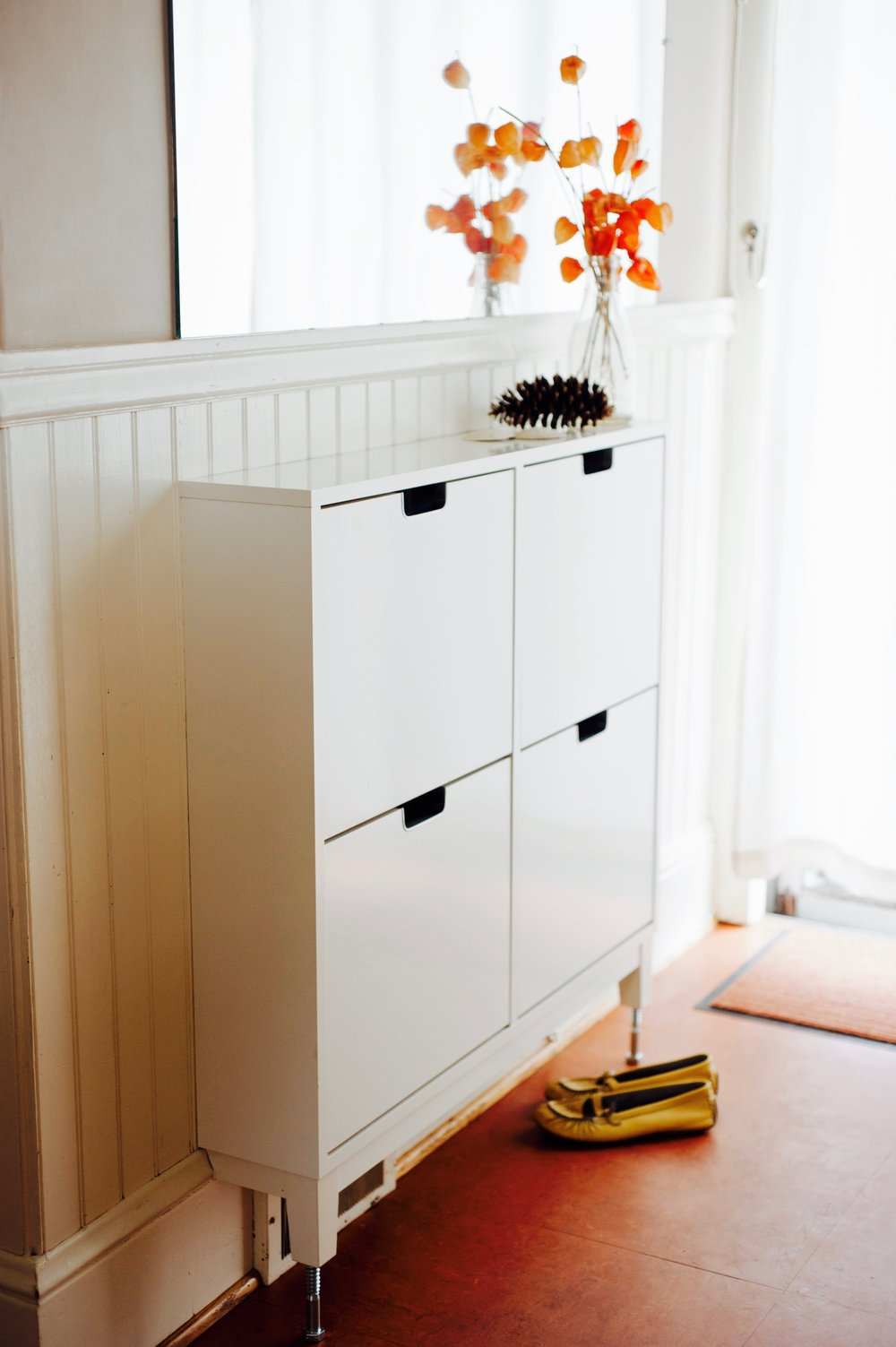 AFTER: Ikea shoe shelf is simple and tidy, and its shiny white surface helps brighten up the whole space.