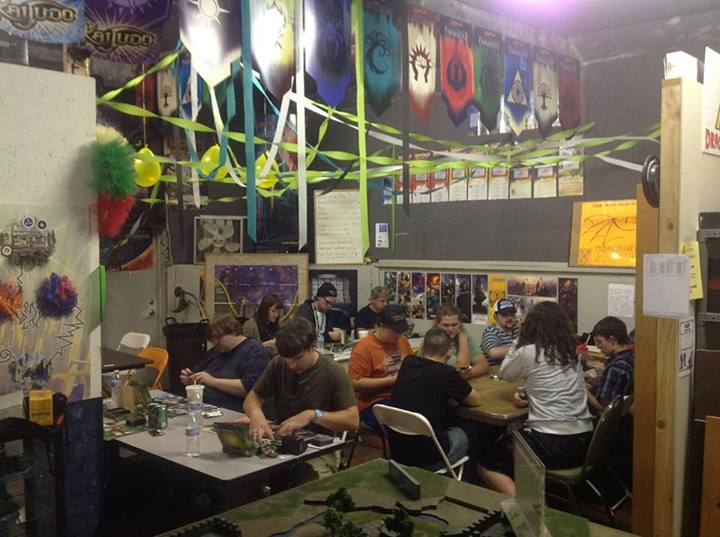 Brian Iadipaolo posted this from Brian's Comics & Games. That Miniatures table. Those Banners! The streamers for dramatic flair!