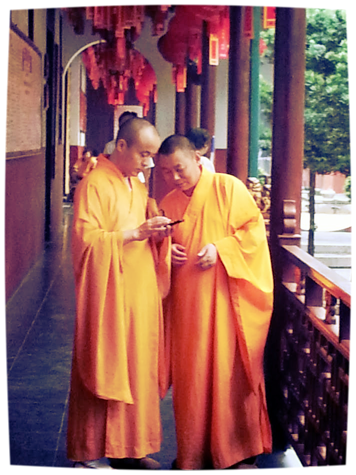 Buddhist Monks on their smartphone