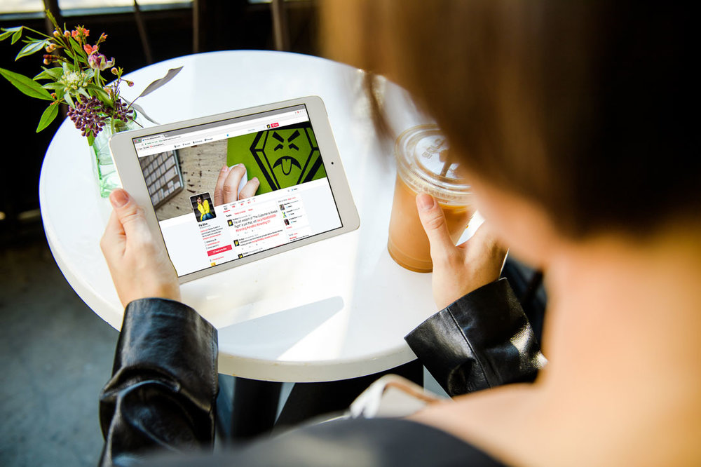 Personal Branding Expert Pia Silva reading her tablet