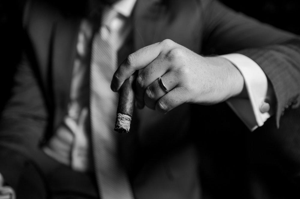 Fine Tobacco NYC Matthias Clock Davidoff branded B&W portrait holding cigar