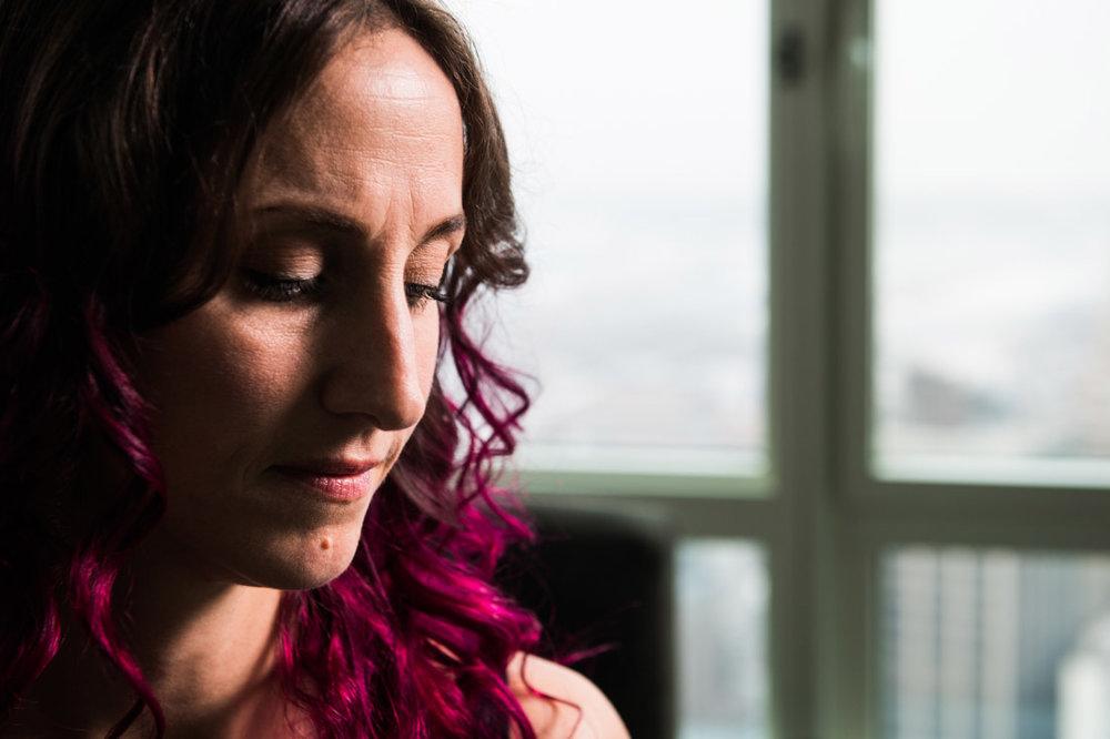 Health Wellness Coach Kristin Weitzel reflective portrait looking down