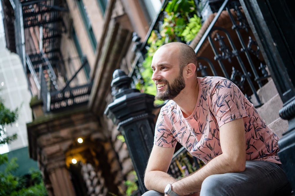 Dutch headshot photographer Maurice Jager branded lifestyle portrait NYC smiling on stoop