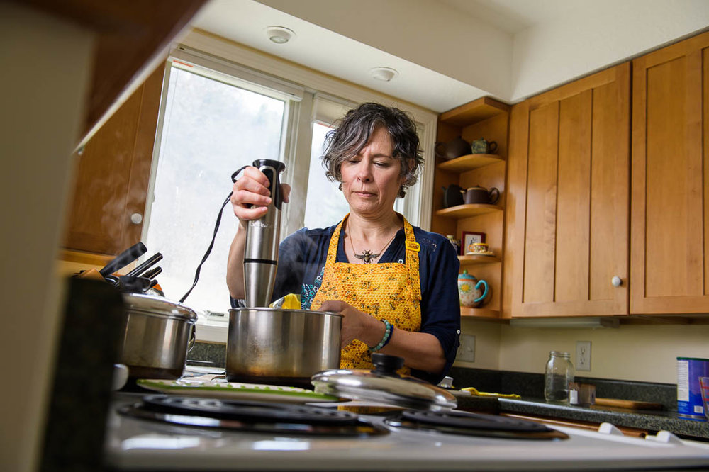NYC branded lifestyle portrait coach healer cooking in kitchen