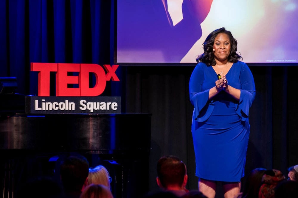 NYC branded lifestyle portrait TEDxLincolnSquare Pamay Bassey focused from stage
