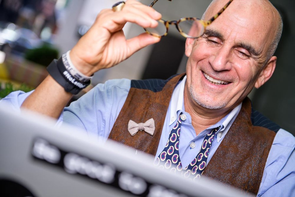 NYC Branded Lifestyle Portrait SpeakerAuthor Thought LEader Ted Rubin smiling at computer
