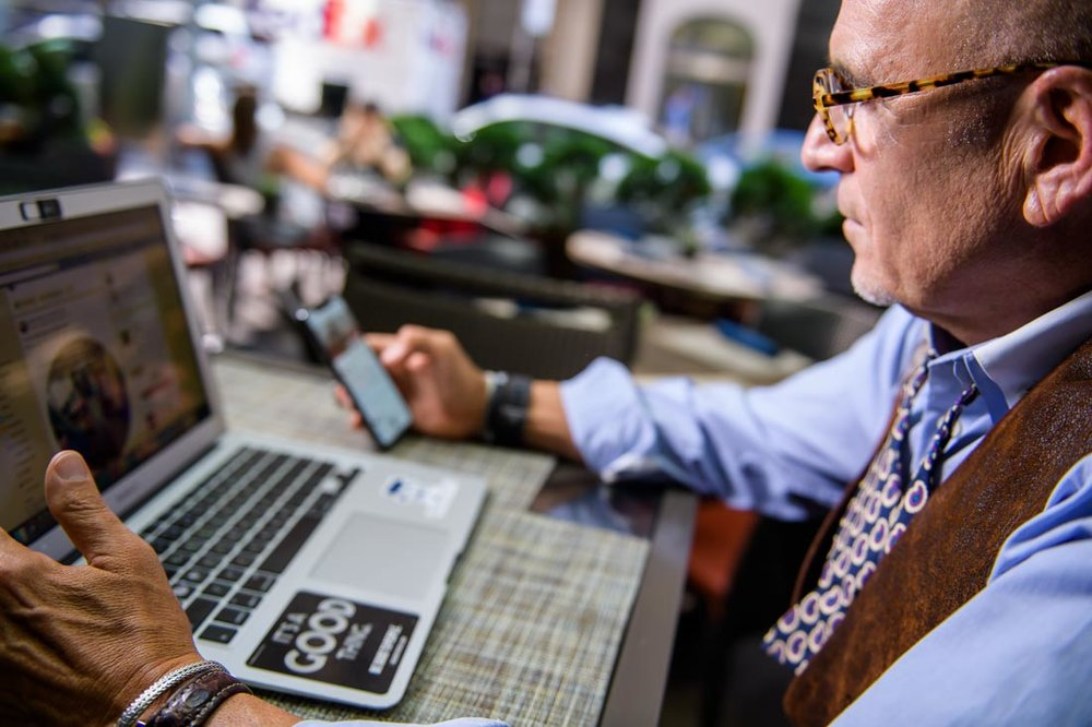 NYC Branded Lifestyle Portrait SpeakerAuthor Thought LEader Ted Rubin checking phone