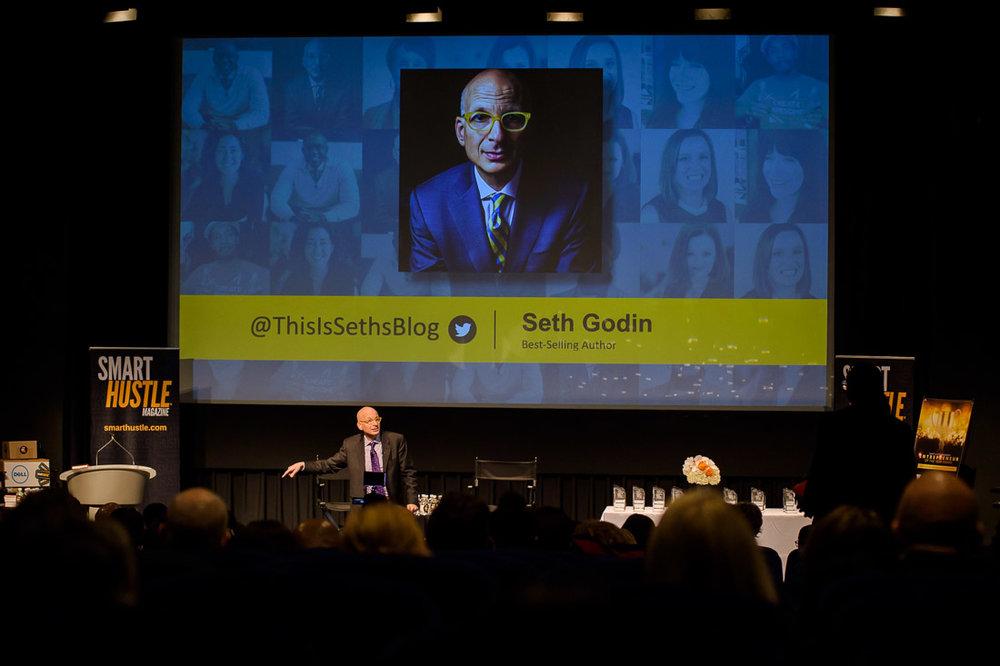 Branded Lifestyle Portrait Seth Godin Smarthustle Conference wide shot of stage