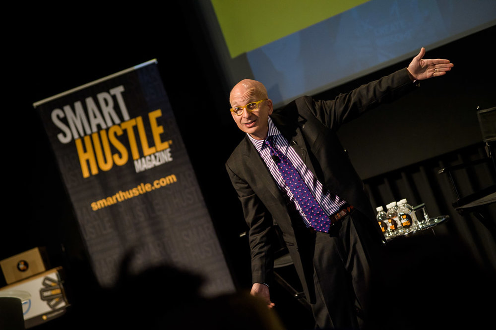 Branded Lifestyle Portrait Seth Godin Smarthustle Conference speaking with attendee