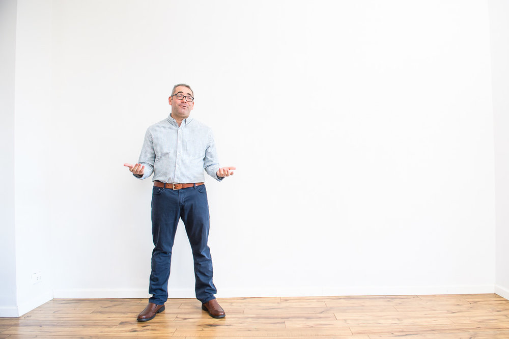 https://www.johndemato.com/branded-lifestyle-portraits-mike-roderick speaking in front of wall