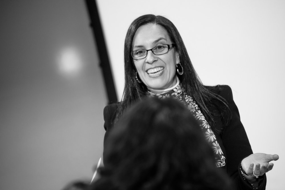 branded lifestyle portrait helena escalante smiling from stage