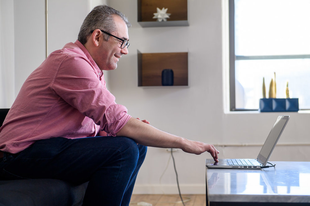 Branded Lifestyle Portrait Mike Roderick on laptop smiling
