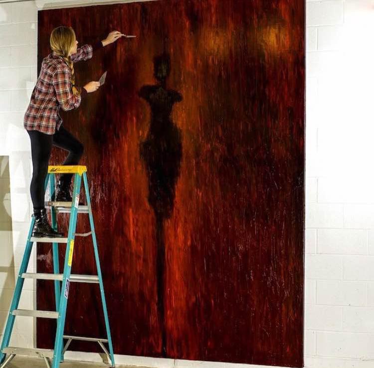 "René Romero Schuler adds final details to her massive piece, ""Big Red"" in the studio. Photographer: Brian Briggs."