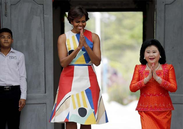 Michelle Obama visiting Cambodia in this retro dress, did we mention her arms look fantastic.