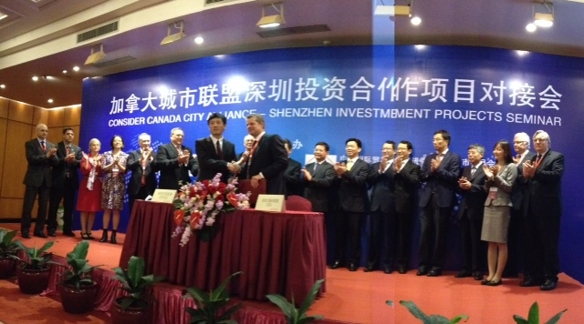 April 16, 2013, Mr. Yongxin Tao, Deputy Director General of CCPIT Shenzhen, and Mr. Bruce Graham, Chair of Consider Canada City Alliance and President of Calgary Economic Development, sign a Memorandum of Understanding (MOU) for Cooperation