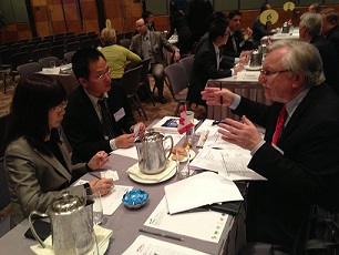 John Jung, CEO Canada's Technology Triangle in business meeting with Chinese