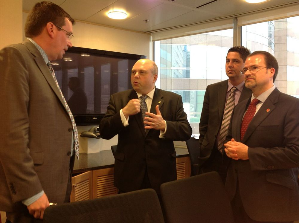 CONVERSATION WITH MINISTER PARADIS. FROM L TO R: MINISTER CHRISTIAN PARADIS, RENATO DISCENZA (INVEST TORONTO), TIM LECLAIR (SASKATOON ECONOMIC DEVELOPMENT)  AND DAVID HARTMAN (INVEST IN CANADA, DFAIT).